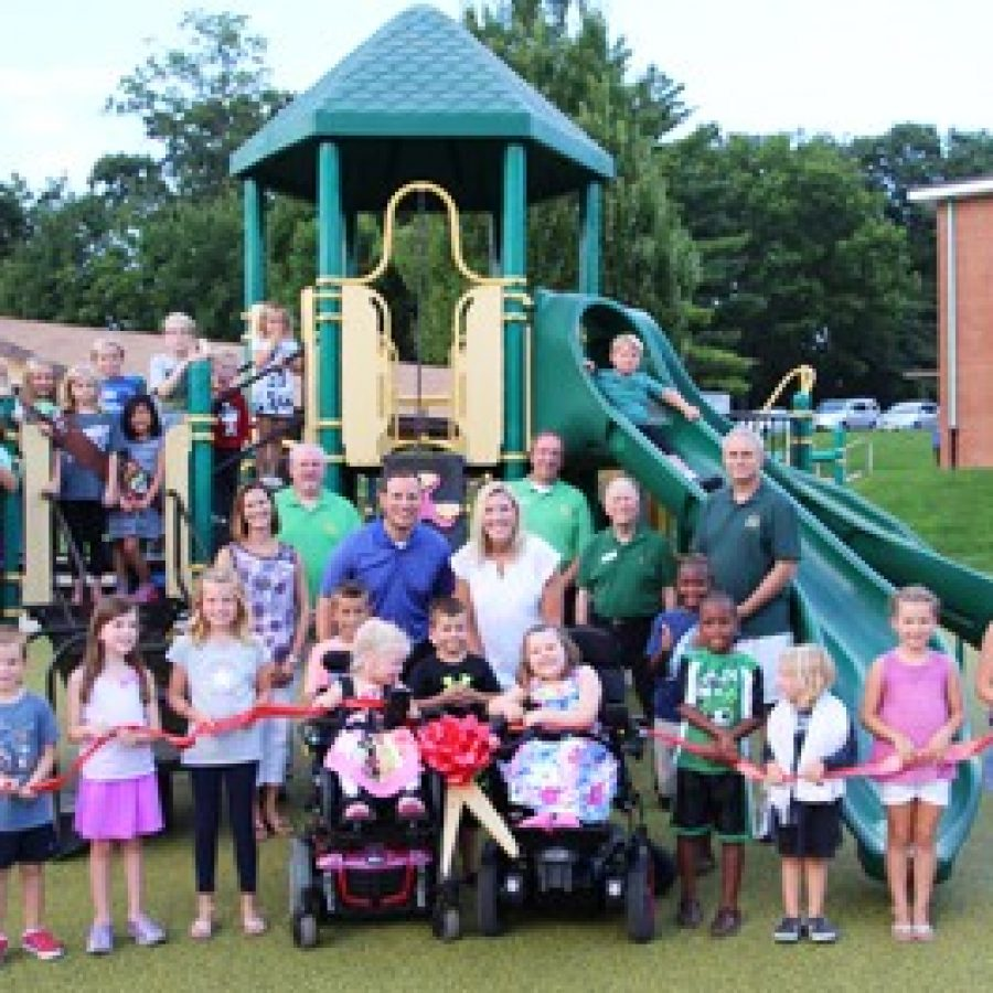 Long Elementary School parent leaders, students and staff celebrate the opening of the school's accessible playground.