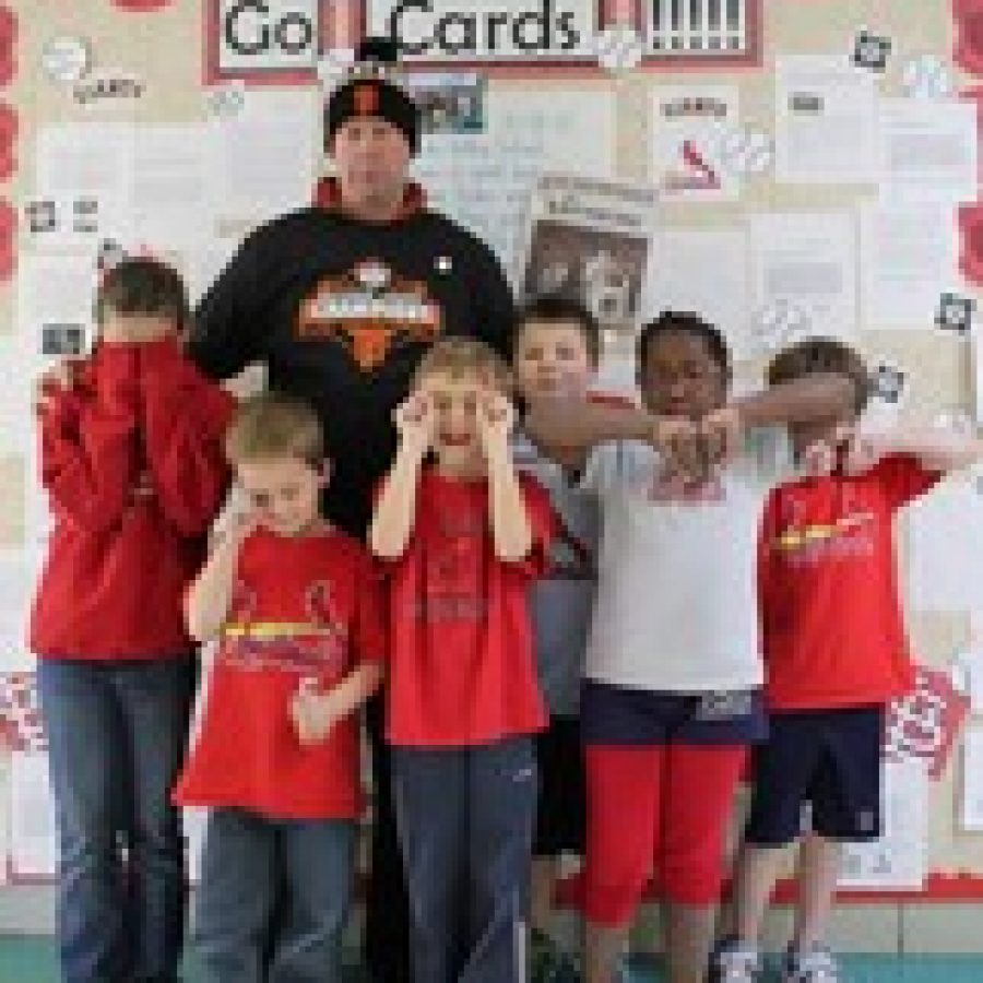 Crestwood Elementary students show their dismay at the Cardinals NCLS loss and their principal Scott Taylor sports San Francisco Giants gear as the result of a losing bet with a school in California.