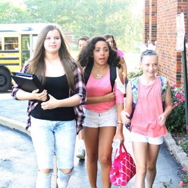 Students arrive at Oakville Middle School on the first day of school last year.