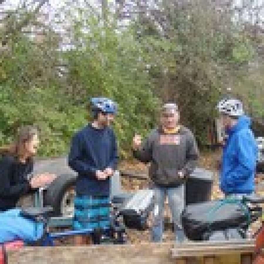 Oakville residents Diane and Tim Doyle talk with Matthew Andrews and Anthony King, of London, about biking along the Katy Trail while Andrews and King pack up to bike to Lawrence, Kan. King and Andrews are cycling around the world in honor of a friend who died from a brain tumor in 2010.
