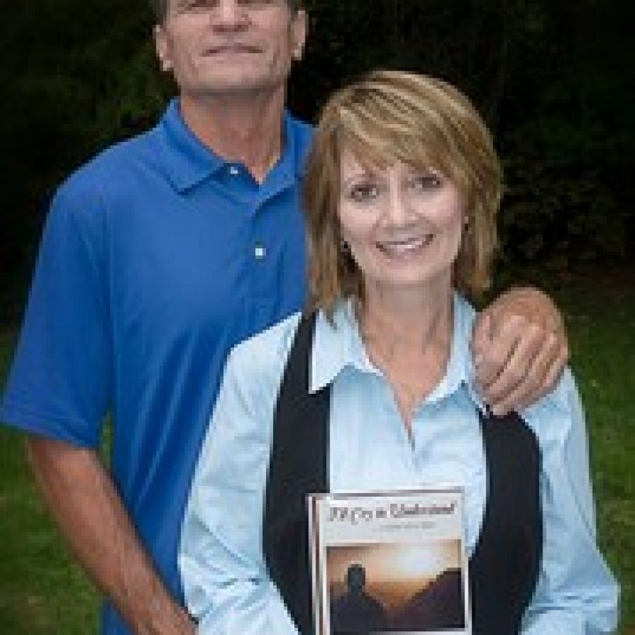 """Karen Weis published """"I'll Cry to Under-stand ... a piece at a time"""" last December to express her emotions after her son Nathan died in a car accident in 2006. Karen is shown with her husband, Dan."""