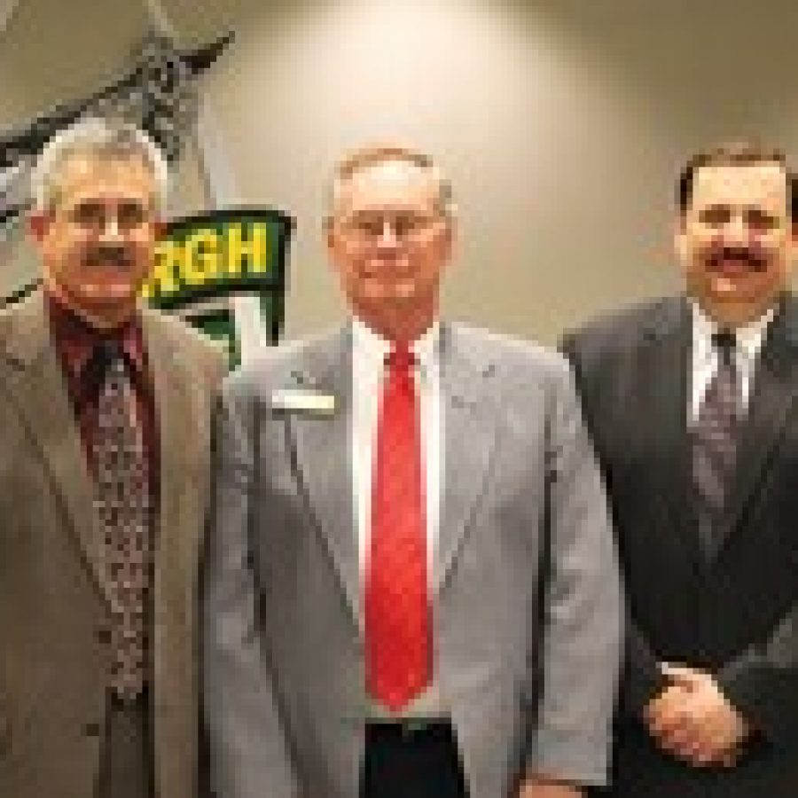Departing board members Ken Fey, left, and Mark Rudoff, right, are shown with Board of Education President Vic Lenz at last week's meeting.