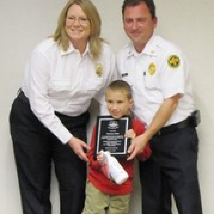 Thomas Hale is shown with Amy Reitz of South County Fire Alarm and Mehlville Fire Protection District Chief Brian Hendricks. Thomas was recognized for his heroic efforts when he called 911 after his mother suffered a seizure.