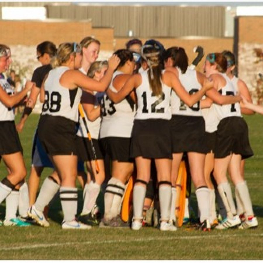 Oakville field hockey players celebrate a tournament victory last year.