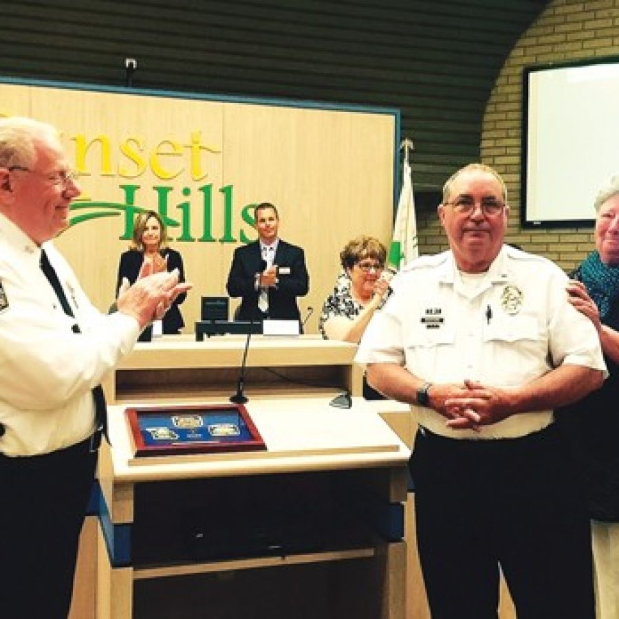 Sunset Hills officials, including Police Chief William LaGrand, left, congratulate Lt. Mike Swofford, who is retiring June 1 after 43 years of service, at the May 10 Board of Aldermen meeting. The chief also recognized Swofford's wife, Becky, for her unofficial contributions to the city and the Police Department. Also pictured in background, from left, are: Ward 4 Alderman Thompson Price, Mayor Pat Fribis, Ward 2 Alderman Steve Bersche, Recording Secretary Carol Lay and City Attorney Robert E. Jones.