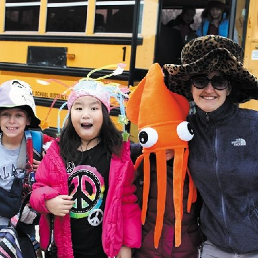 Lindbergh students, staff don hats for flood relief