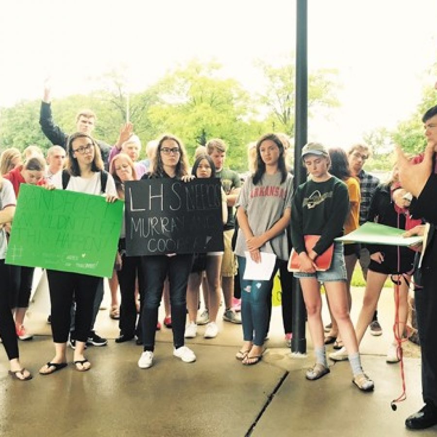Lindbergh Superintendent Jim Simpson, right, talks to Lindbergh High School students and alumni who staged a 'sit-in' at Central Office on the last day of school Friday until Simpson accepted their 800-signature petition that calls, among other things, for a tax-rate increase to fund higher teacher salaries. Earlier in the week, the students walked out of school in protest.