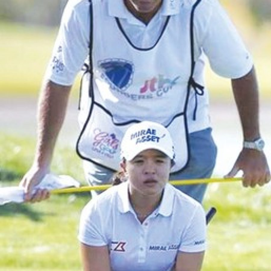 South county native Paul Fusco is caddying in the Olympics this week for the sixth-ranked golfer in the world, Sei Young Kim.