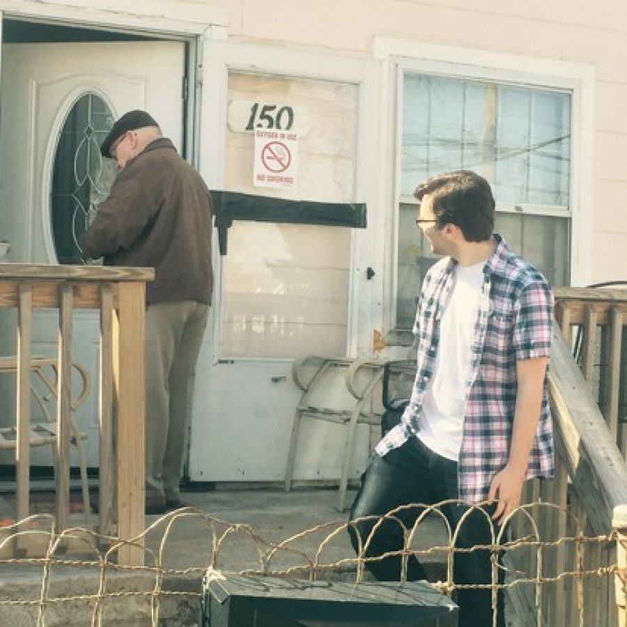 Hancock High School senior Timothy Walden, right, and Rep. Bob Burns, D-Affton, deliver Meals on Wheels to a senior citizen in Lemay on Good Friday, when regular volunteers were unavailable.