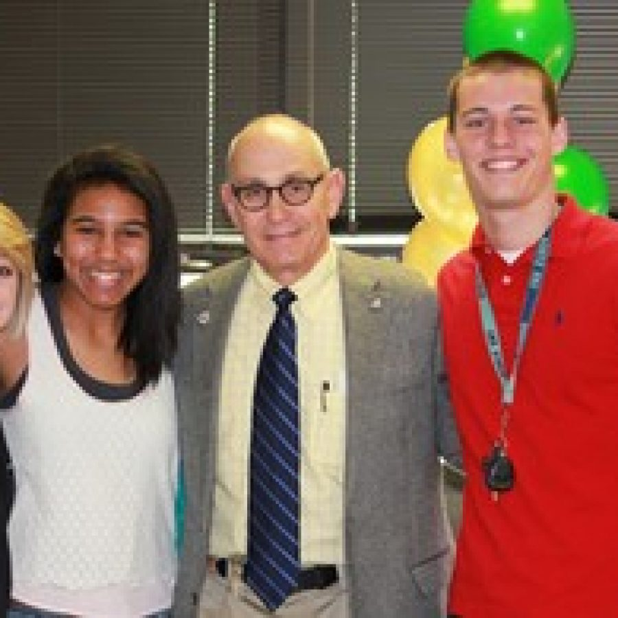 Lindbergh High School students, from left, Jordan Ward, Leah Dents and Chuck Houska celebrate with Principal Ron Helms, who was named Educator of the Year by the St. Louis Association for Secondary School Principals.