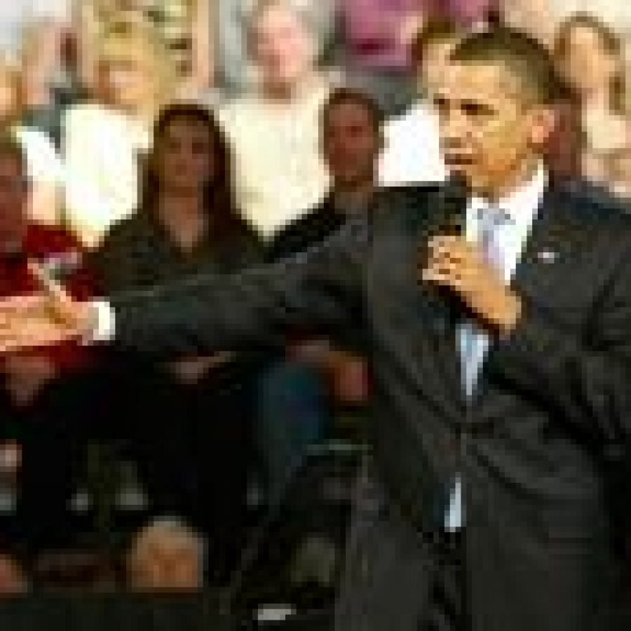 President Barack Obama discusses his first 100 days in office in a packed Fox Senior High School gym in Arnold.