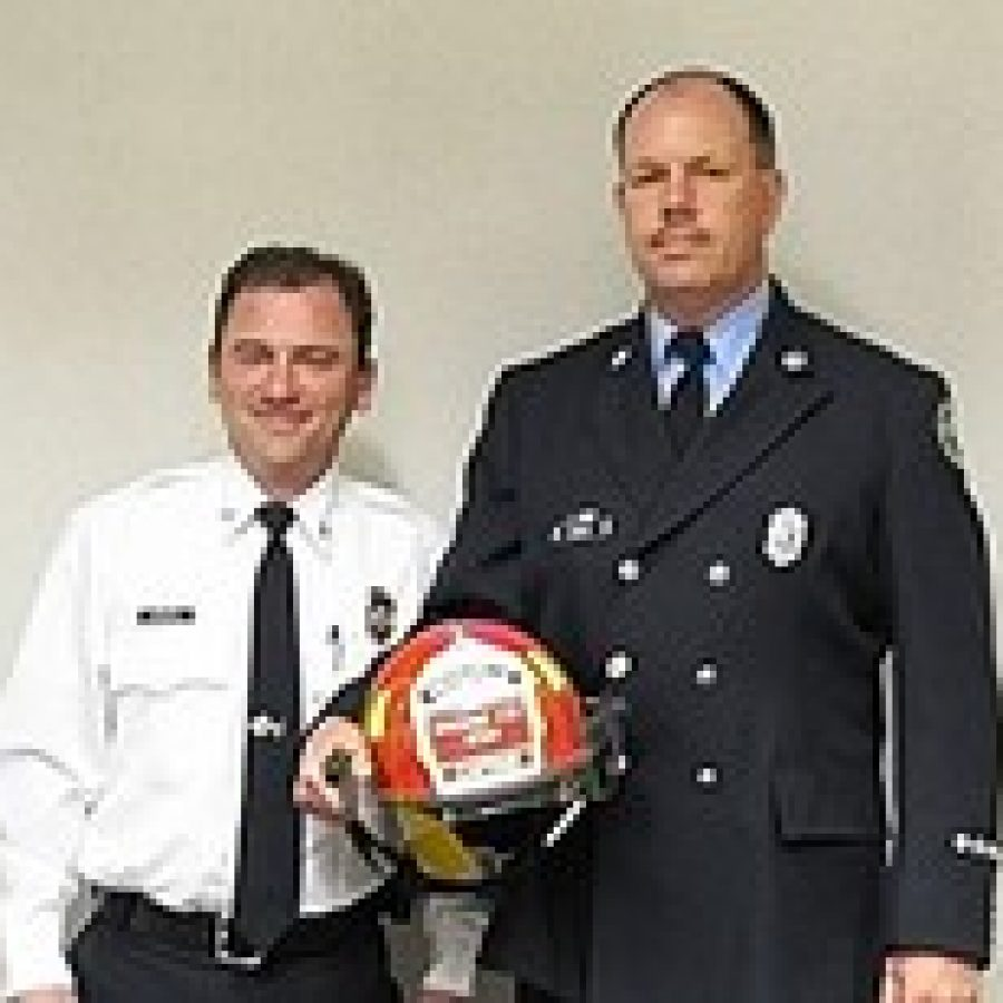 Chief Brian Hendricks is pictured with Capt. Daniel Rosenthal.