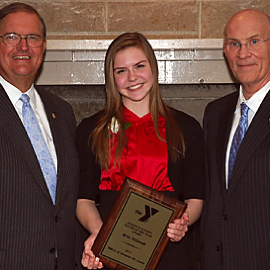 Lindbergh High School student Erin Vilimek displays her YMCA Youth of the Year Award at last week's YMCA of Greater St. Louis' annual Youth of the Year Awards Dinner. Pictured with Vilimek are Gary Schlansker, left, president and chief executive officer of the YMCA of Greater St. Louis, and Rick Boyle, vice president of human resources and dean of faculty at Lindenwood University.