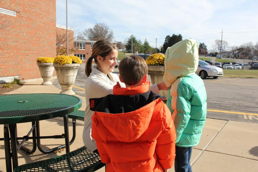 Sappington Elementary School Counselor Carolyn Hubert helps students try on new coats provided by the Crestwood-Sunset Hills Rotary Club's Operation Warm program. The Rotary Club donated 104 coats, 60 hats and 60 pairs of gloves to Lindbergh students in 2015.