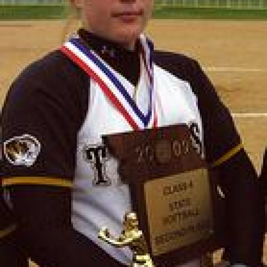 Oakville senior catcher Maggie Ruckenbrod stands proudly clutching the trophy for taking second place in the Missouri Class 4 State Softball Championships at St. Joseph Heritage Park. Bill Milligan photo