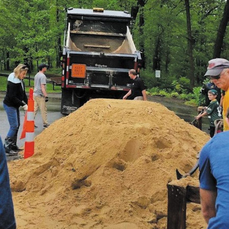 The city of Sunset Hills provided sandbags to residents impacted by last week's flooding. Volunteers responded in force to the city's call to fill the sandbags at Watson Trail Park, above.