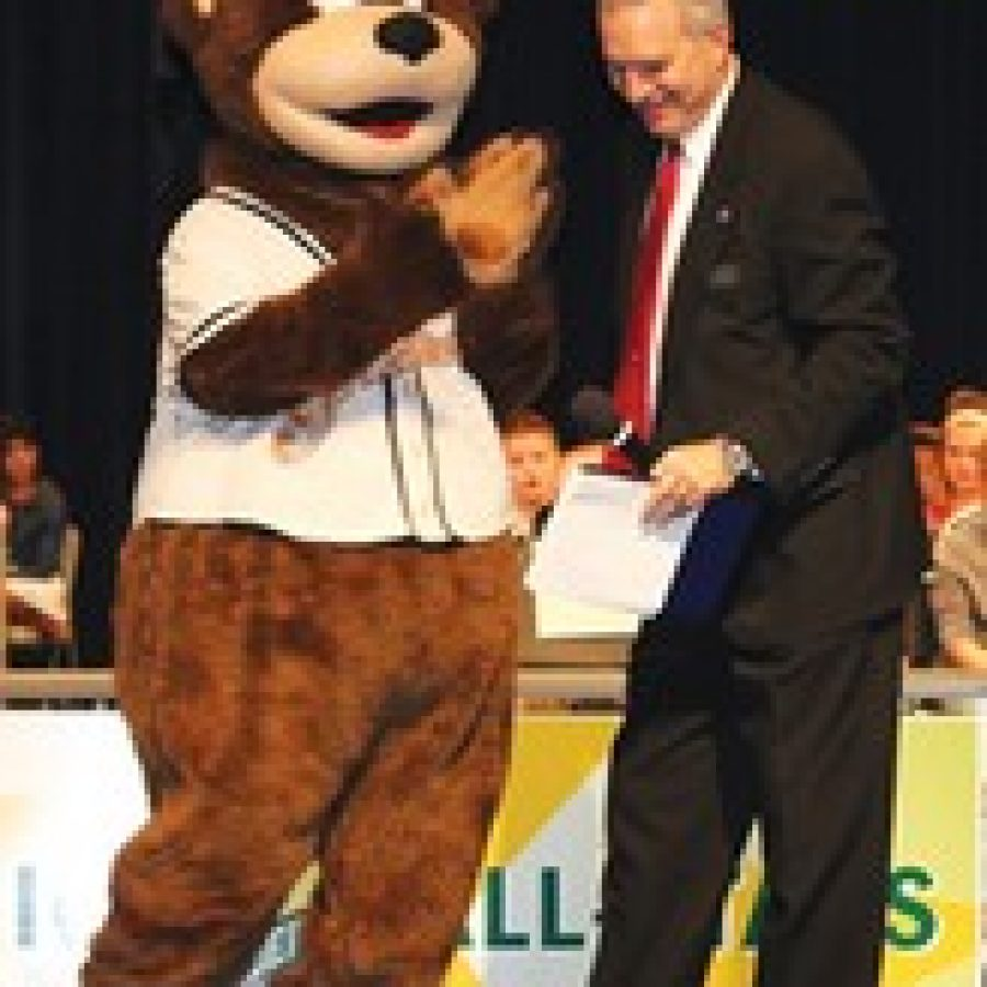 Lindbergh Schools honored 1,600 students in grades four through eight for their outstanding academic achievement at three Academic All-Stars evenings. The event is made possible by several community business sponsors. Above, Superintendent Jim Simpson jokes around with Izzy the Grizzlie, mascot for the Gateway Grizzlies, on Nov. 25.