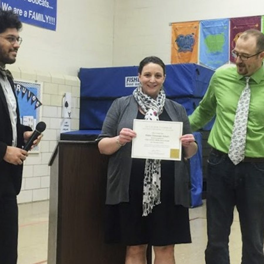 Blades Elementary School was honored Friday as the 10,000th affiliate school nationwide of the Gilder Lehrman Institute of American History, which provides free resources to improve the teaching of American history in schools. English-Language Learner teacher Jamie Williams wrote an essay to nominate the school in December. At the ceremony, from left, are: Daniel Pecoraro of the Gilder Lehrman Institute, Williams and Blades Elementary Principal Jeremy Booker.