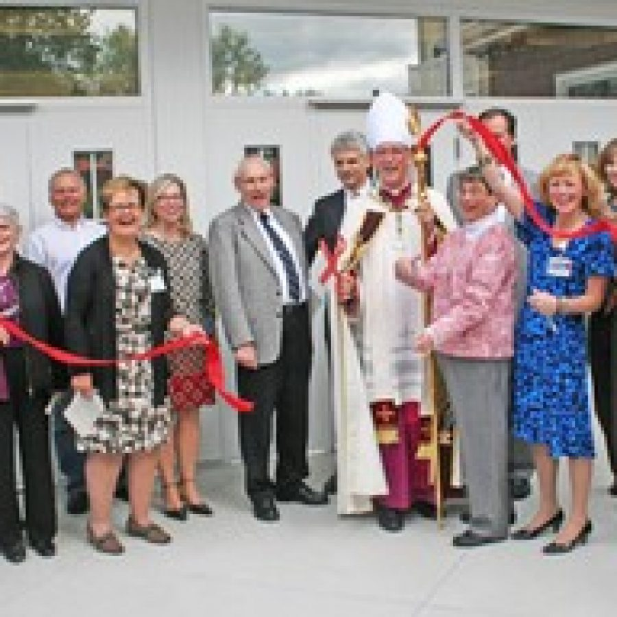 The Most Rev. Edward Rice is joined by Nazareth Living Center volunteer leaders, administrative staff and Paric Construction representatives at the grand opening of the independent living apartments of the Village at Nazareth. (