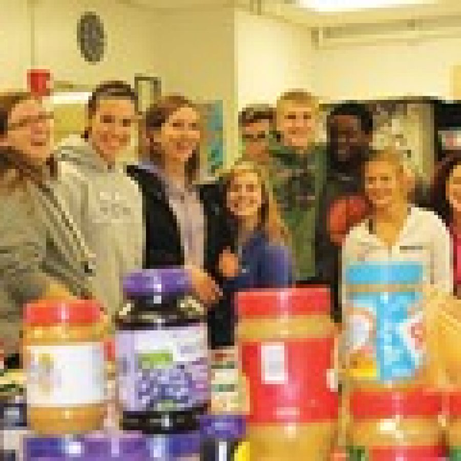 Mehlville Senior High School students in Jane Perrica's leadership class unpack some of the food items collected during a recent community food drive for the school's student pantry. Pictured, from left, are: Alaina O'Neill, Tara Becker, Alexa Dell, Emma Torno, Bailey Miller, Ian Hurt, Shane Burke, Marc Jones, Amber Rickert, Emily Ackels and Rachel Benesh.