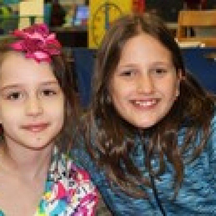 Wearing their pajamas at Bierbaum's fundraising event are Ayla Durakovic, left, and Arijana Hasic.