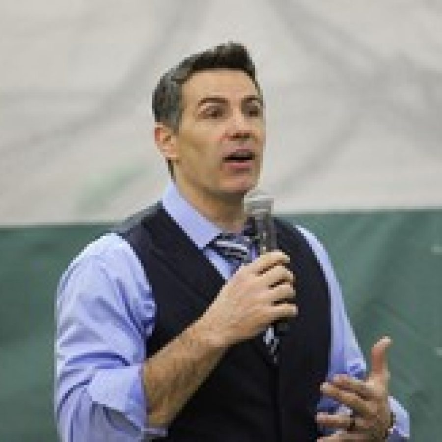 Former St. Louis Rams quarterback Kurt Warner addresses Lindbergh High School students during the CHEER assembly to promote ability awareness.