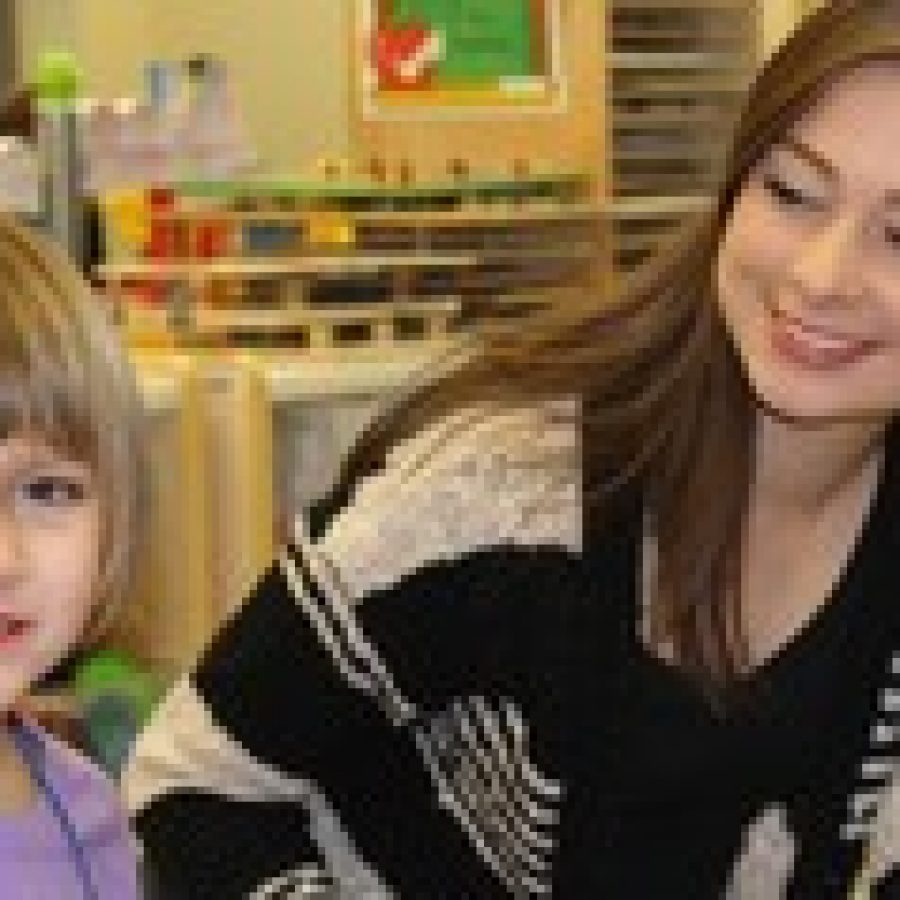Mehlville High School seniors visited the much-younger students at the John Cary Early Childhood Center, or JCECC. Judging from the preschoolers' reactions, last week's visit was a smashing success. Mehlville High senior Alyson Potje, above, spends some time with JCECC student Emma Ruzicka.