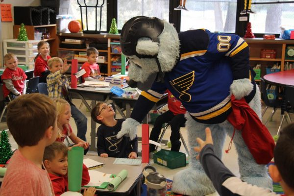Louie befriended a first-grade student who was also wearing a St. Louis Blues shirt while collecting letters for Santa on Dec. 7, 2018.
