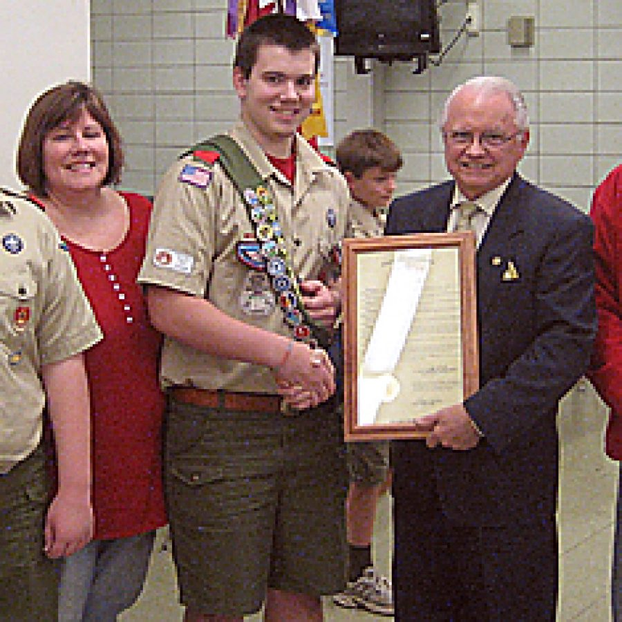 Rep. Walt Bivins presents an Eagle Scout resolution to John Patrick Carman at Washington Middle School. Pictured, from left, are: Nick Carman, Linda Carman, John, Bivins and Rick Carman.