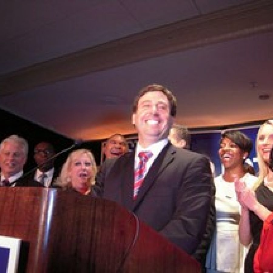 Sixth District Councilman Steve Stenger, D-Affton, promises his supporters at his victory party that he will restore their faith in county government. Pictured, front row, from left, are: 5th District Councilman Pat Dolan, D-Richmond Heights, who won re-election; Stenger's sister Debbie Mourning; Stenger; Leslie Broadnax; Stenger's wife Allison; and former Sen. Betty Thompson.