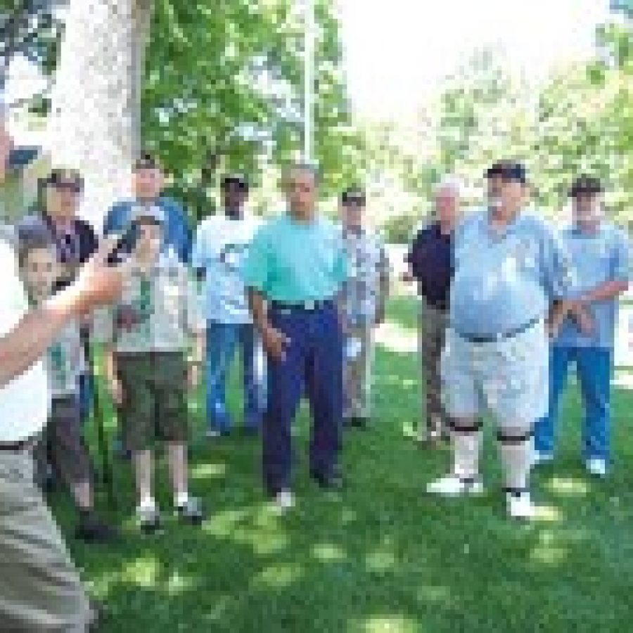 Flagpole dedication at Father Dickson Cemetery.