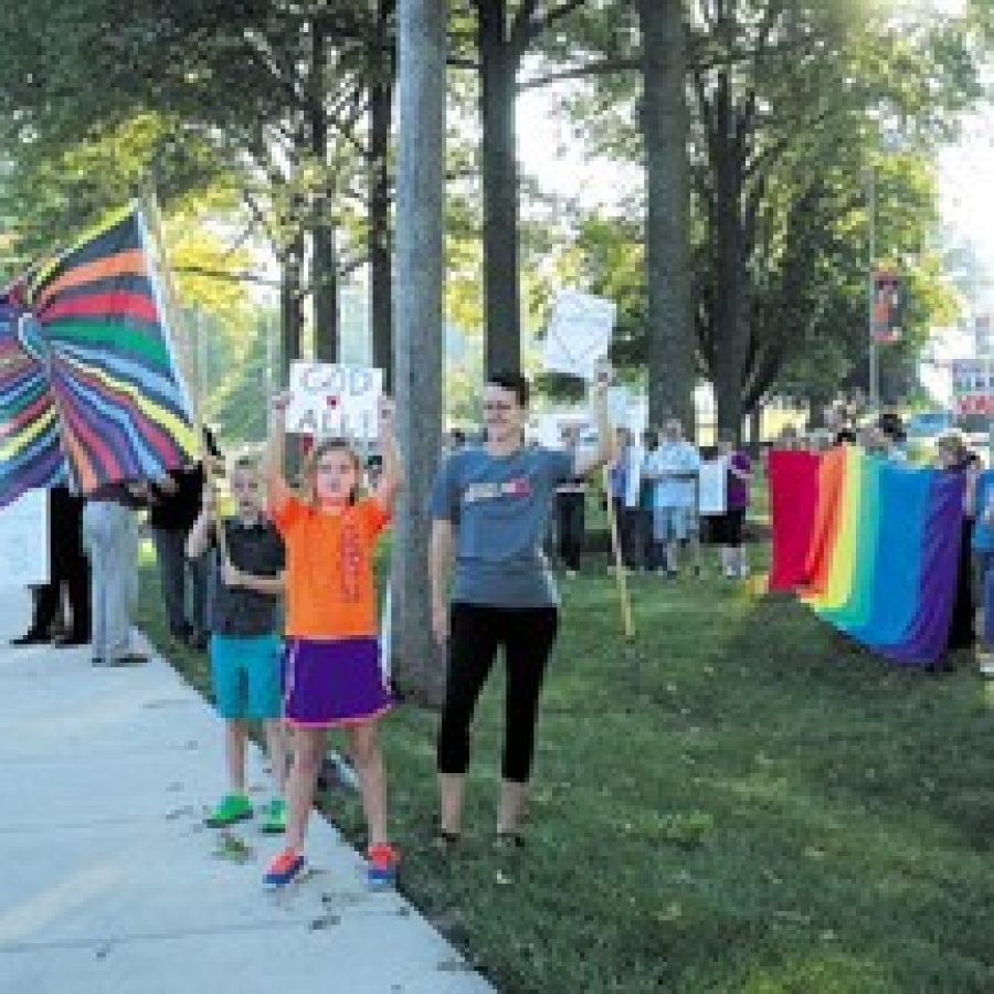 To show support for current gay students at Cor Jesu, the statewide coalition Show Me No Hate held a peaceful protest outside the school as students arrived for classes on Friday. Photo by Gloria Lloyd