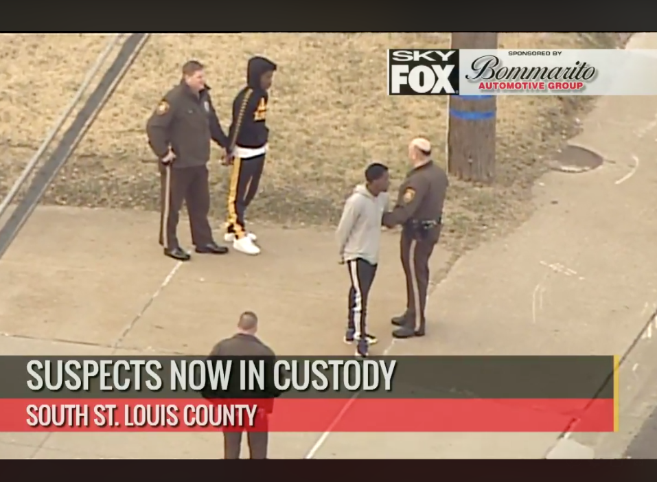 Two+suspects%2C+in+handcuffs%2C+are+taken+into+custody+by+police+on+Union+Road+in+south+county+Tuesday+morning.+Photo+is+taken+from+live+coverage+of+the+Skyfox+helicopter+from+Fox+2.