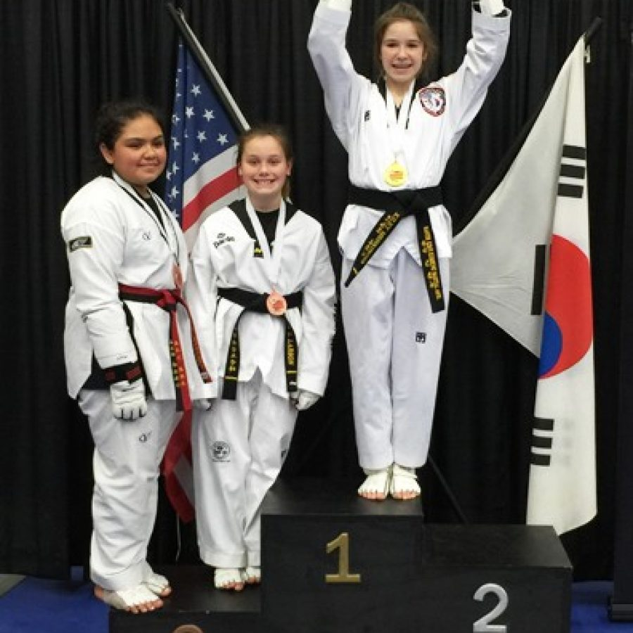 Truman Middle School sixth-grade student Kiley Mehringer displays the Gold Medal she earned for the Youth 10-11 Heavyweight Division in Sparring.