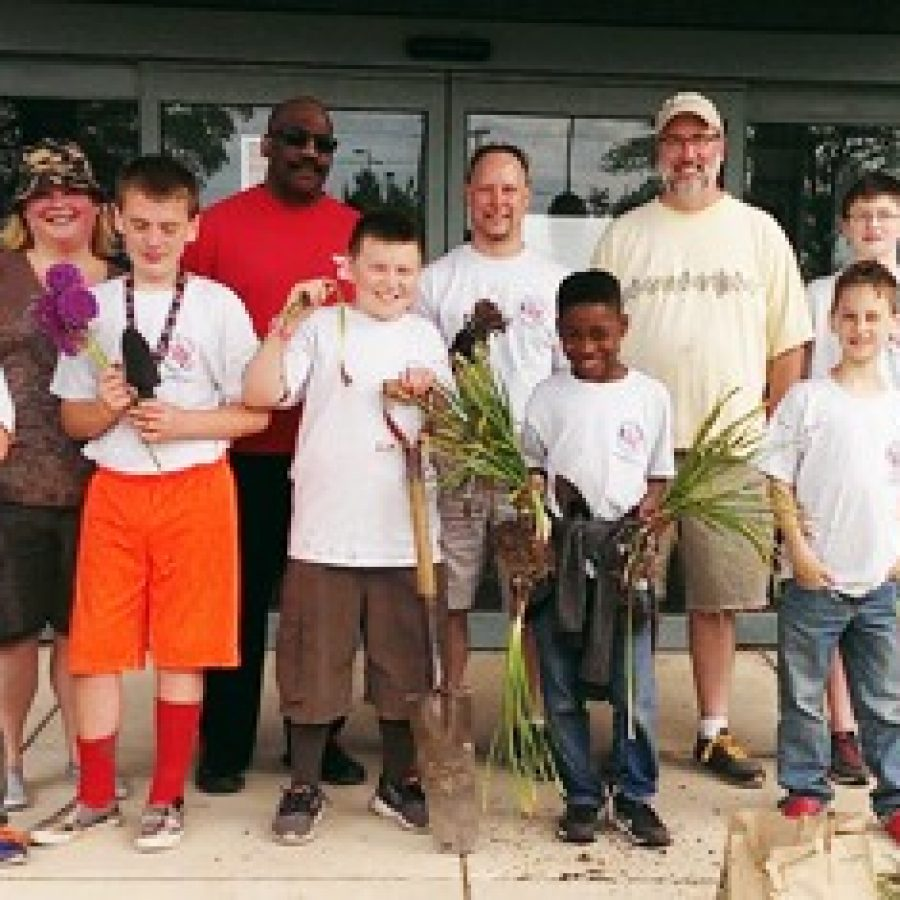 Boy Scouts save flower bulbs from mall property