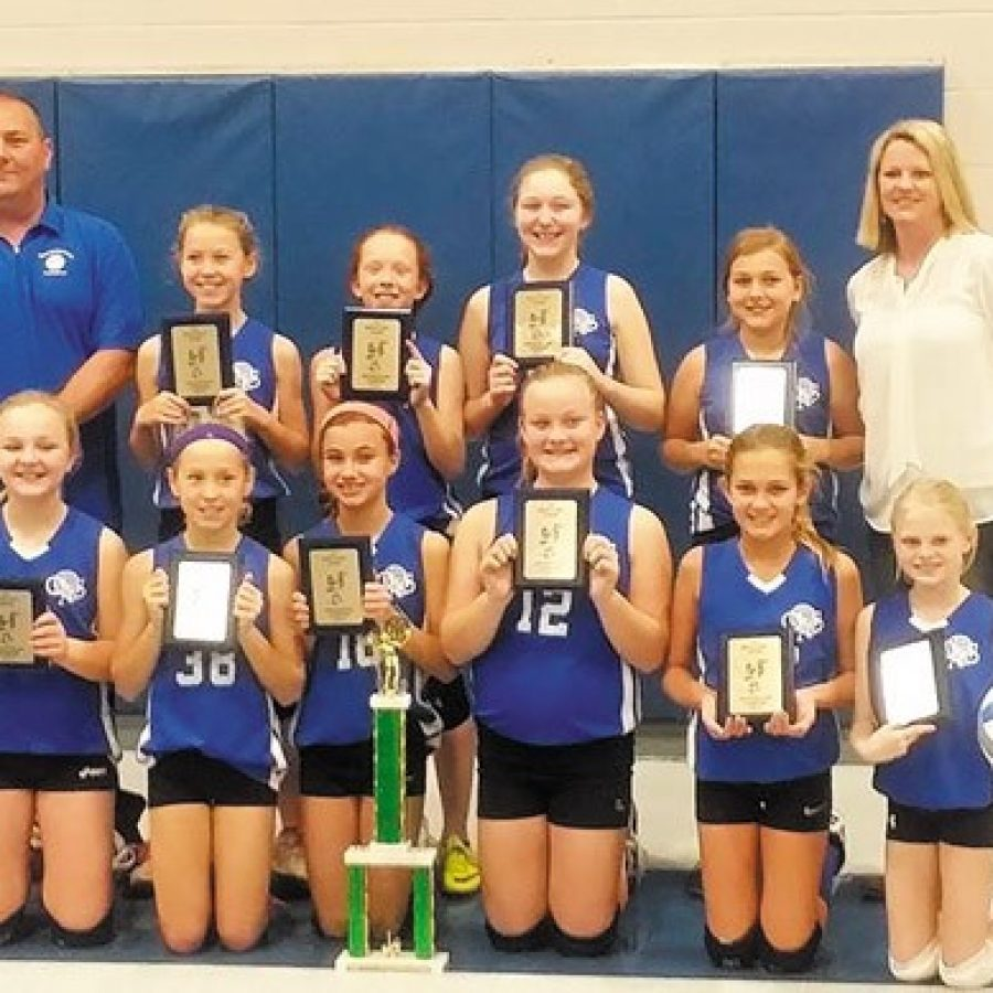 The Queen of All Saints fifth-grade championship volleyball team