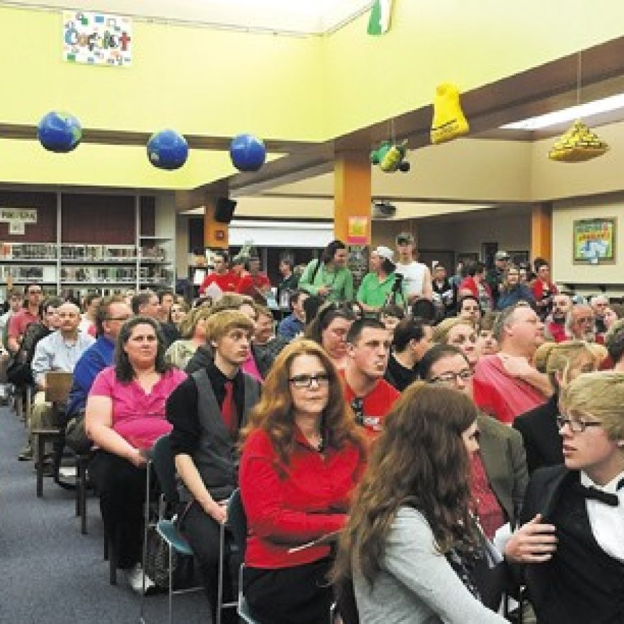 A sea of teachers and students wearing red in support of the district's teaching staff stood out in the crowd of roughly 400 when the board met last week in the Mehlville High School Library for a first look at a list of \$4 million in proposed budget cuts.