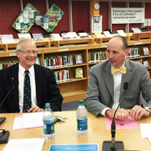 Incoming Mehlville Superintendent Chris Gaines, right, attends his first Mehlville Board of Education meeting with Superintendent Norm Ridder, left.