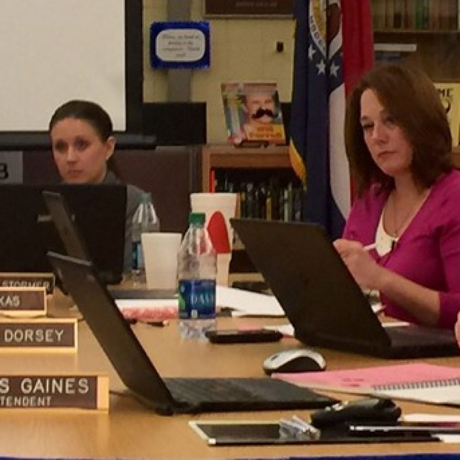 Board members listen as district parents call for Mehlville Board of Education member Lori Trakas to resign. Pictured from left, Secretary Samantha Stormer, Trakas and Lisa Dorsey.