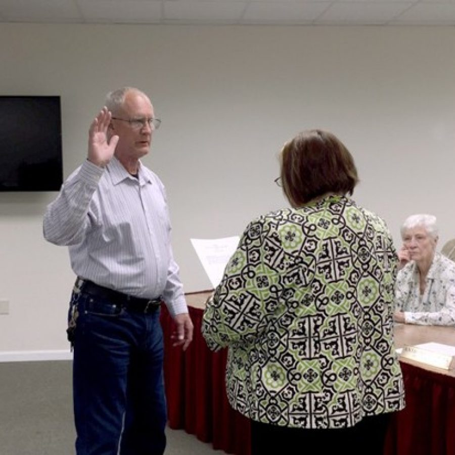 Green Park Ward 1 Alderman Michael Broughton, left, is sworn into office by City Clerk/City Administrator Zella Pope in April.