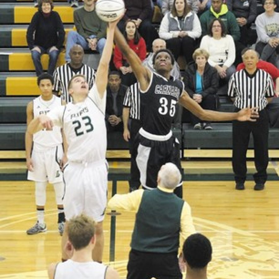 Lindbergh High School recently celebrated the grand reopening of Gym 3, kicking off a winning home opener for the Flyers, as they defeated Carnahan High School 71-48. Retired Lindbergh High basketball coach and current Board of Education Vice President Don Bee tossed a ceremonial jump ball to get things started. Above, starting centers Greg Lahm, 23, of the Flyers and Tyrone Wright, 35, of Carnahan tip off on Bee's ceremonial jump ball.