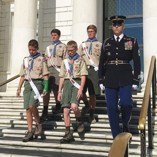 The Troop 824 Honor Guard is pictured with an escort during its visit to Arlington National Cemetery to place a wreath at the Tomb of the Unknown Soldier.