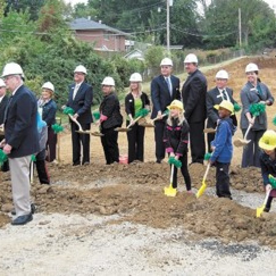 Lindbergh Schools students, administrators, Board of Education members and Missouri Board of Education Vice President Vic Lenz, right, join Ollie Dressel, left foreground, Friday morning in breaking ground for the new 650-student Dressel Elementary School. Mike Anthony photo