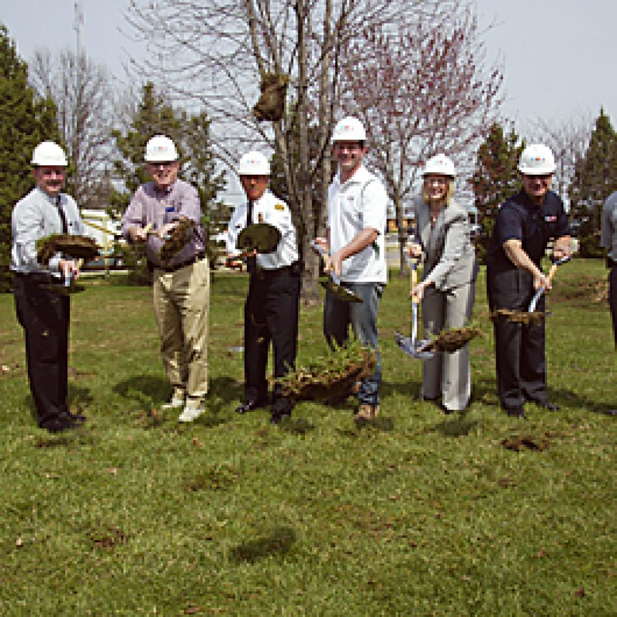 Breaking ground for the new No. 3 Firehouse, from left, are: Lance Woelfel of Archimages, Roy Mangan of Archimages, board Secretary Ed Ryan, Chief Tim White, board Chairman Aaron Hilmer, board Treasurer Bonnie Stegman, Sen. Jim Lembke of Lemay and Josh Foster of the J.E. Foster Building Co., contractor for the project. Bill Milligan photo