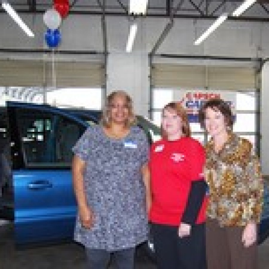 Admiring the newly recycled ride, from left, are: foster mother Phyllis Hackman, Gapsch General Manager Lisa Rush and Angels' Arms Executive Director Bess Wilfong.
