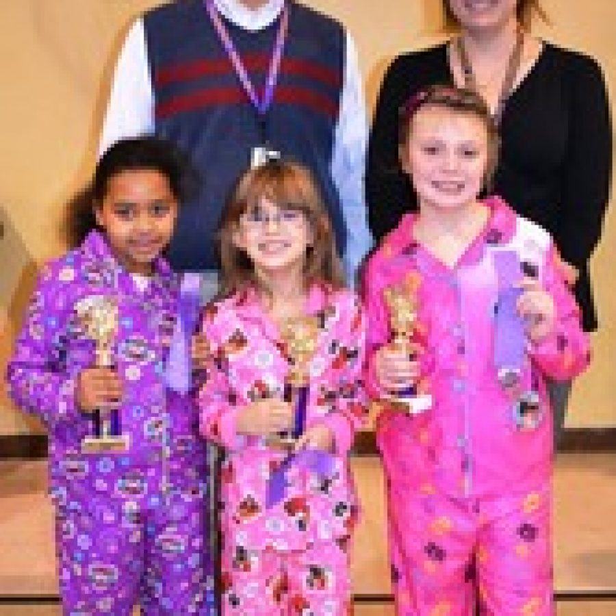 Gotsch Intermediate School Principal, Brian Smith, and Laura Pezzani, gifted and talented teacher, with third-grade spelling bee winners from left to right Helen Shannon, 1st place, Ela Potera, 2nd place, and Claire Burmester, 3rd place.