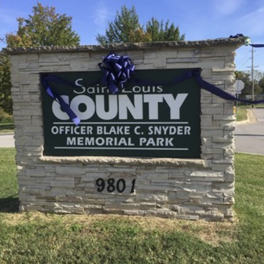 Signs for the new Officer Blake C. Snyder Memorial Park were installed at the former Clydesdale Park Thursday, after the park was renamed Tuesday night by County Executive Steve Stenger. Gloria Lloyd photo