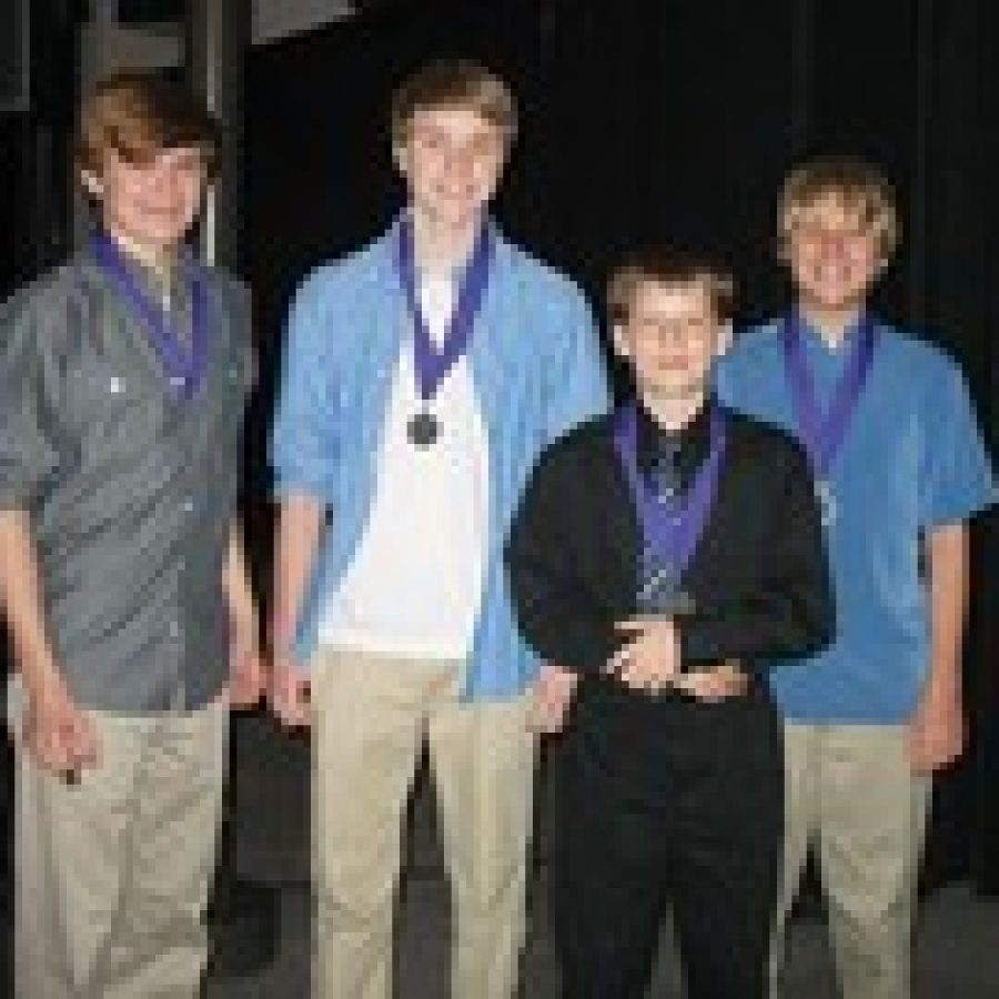 Bernard Middle School eighth-graders l-r Mitchell Elliot, Daniel Golob, Iain Bennett and Danny Bitter were honored on April 17 for earning first place in their division of the St. Louis region in the Missouri Stock Market Game. Six teams from the Mehlville School District placed first or second in their division during the game.