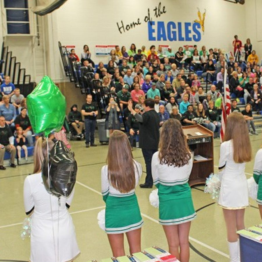 Above, the Mehlville Pantherettes and Oakville Golden Girls made a rare joint appearance at an Oct. 24 rally for Prop R at Washington Middle School.