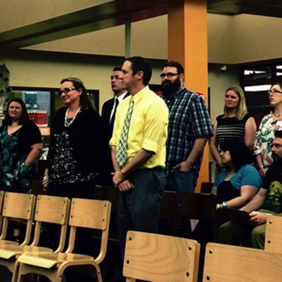 The implementation team for the new Mehlville Choice School of Innovation stands up to be recognized at last week's school board meeting. Team members include Rogers teacher Lisa Meyers, left, Oakville Elementary Principal Chad Dickemper and Oakville Elementary parent Mike Sita, middle.
